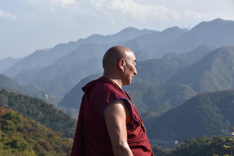 Monk at the Great Wall of China