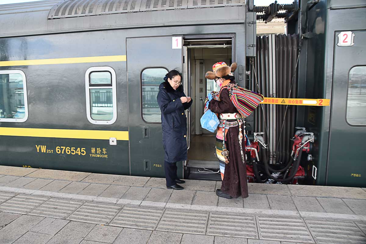 A Tibetan entering the train to Lhasa